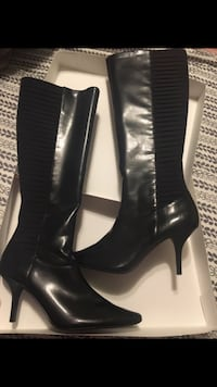 pair of women's black patent leather heeled heeled boots with box screenshot