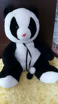 black and white bear plush toy