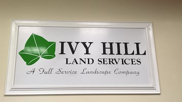 Ivy hill land services signage with white wooden frame