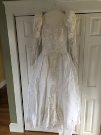 Beautiful wedding gown with cathedral length train and veil.  Size 8. Professionally cleaned and preserved North Andover, 01845