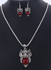 silver-colored owl designed red gemstone pendant necklace with earrings