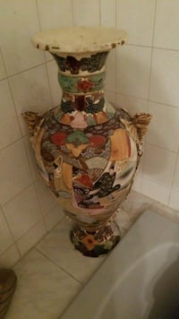 white, red, and green floral ceramic vase Montreal, H3R 3L4