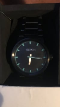 Brand new Females or kids Nixon watch with glow in the dark so you can read the time in the dark.. Still in the box never worn  Orlando