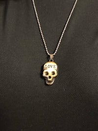 Skull with love pendent on necklace