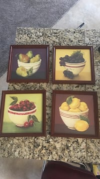 Four assorted fruits painting with brown wooden frames