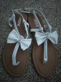 women's pair of white-and-brown Ardene sandals