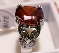 silver-colored and red gemstone ring Vancouver, V5V 4X5