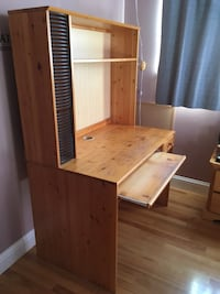 Brown wooden desk with display hutch