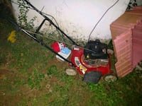 red and black push mower 24 km