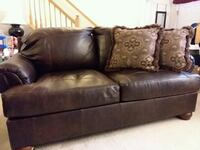 brown leather loveseat. Frederick, 21703