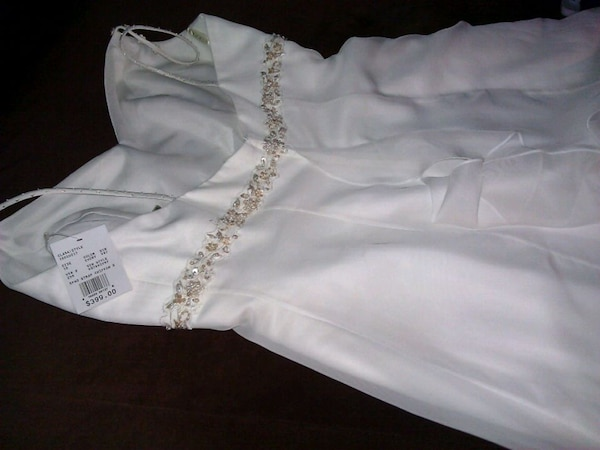 Wedding dress and veil.  With beaded trim. Brand new. Tags on. 33811f85-43f4-427c-8536-49e19cddfba0