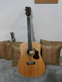 Acoustic Guitar. First Act (Good for a beginner)