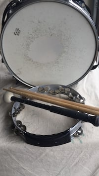 Black and white snare drum with drum sticks and tambourine