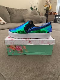 Green-and-blue low top sneakers on box