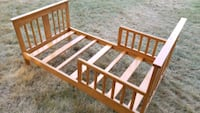 brown wooden bed frame without mattress