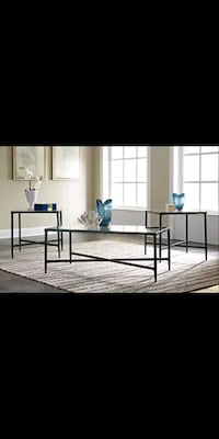 Glass and black metal coffee table with 2 matching end tables