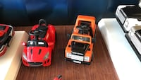 toddler's two red and orange ride-on toy cars