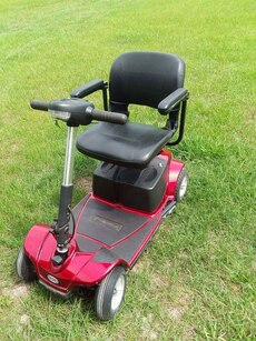 red and black power chair