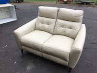 New tan leather power reclining loveseat