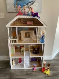 Doll house and barbies