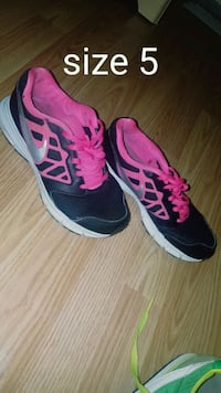 pair of black-and-pink running shoes St. Louis, 63123