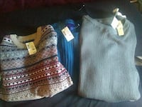 three assorted sweaters