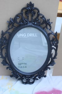 round black wooden framed mirror