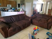 brown suede sectional couch with throw pillows Cape Coral