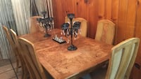 rectangular brown wooden table with eight chairs dining set