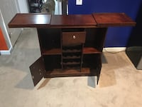 brown wooden single pedestal desk Alexandria, 22312
