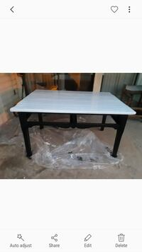 Sturdy wooden table. Sanded and painted