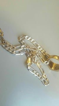 gold-colored and silver-colored bracelet