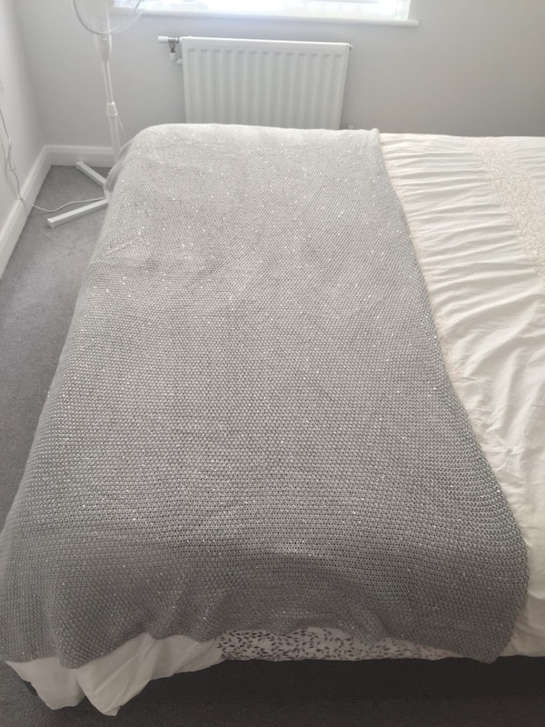 gray and white bed sheet