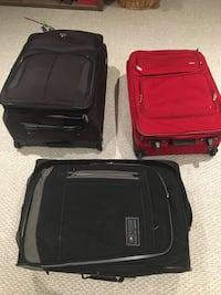 Red and two black travel luggages Hamilton, L8B 0T2