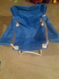 Blue fold out chair also has a bag to care it in