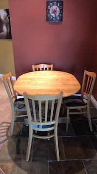 round brown wooden table with four chairs dining set null, T1S 4M2
