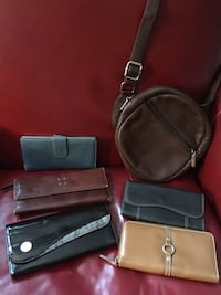 Various wallets and round brown small bag Lowell, 01852