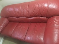 Red leather couch  Calgary, T3B