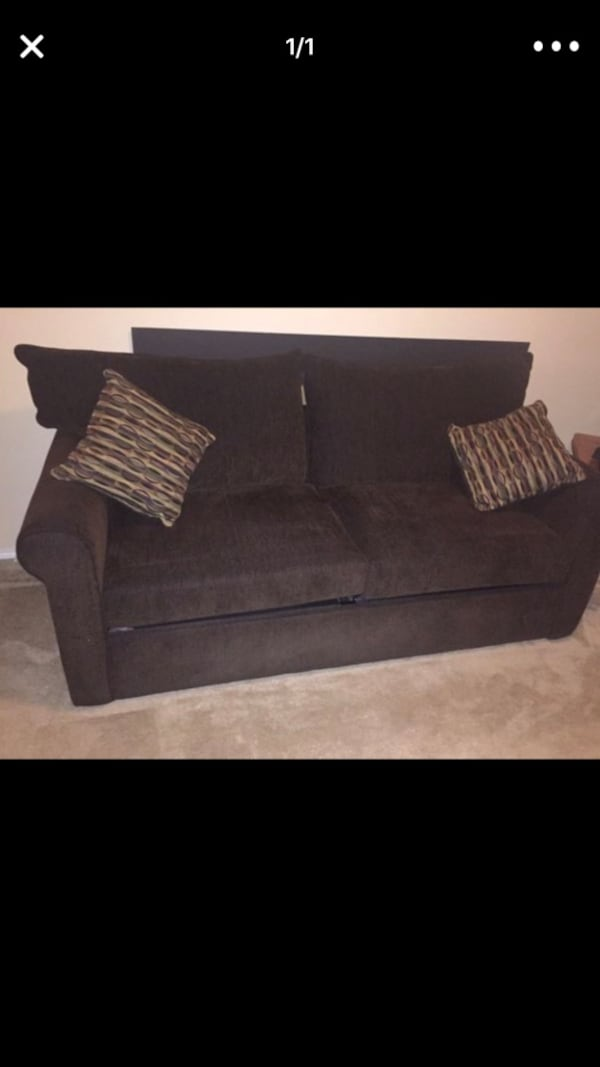 Sold Brown Fabric 2 Seat Sofa Bed