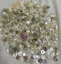 Lots of mother of pearl buttons