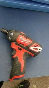 red and black Milwaukee cordless impact wrench Baltimore, 21224