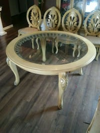round brown wooden framed glass-top coffee table Albuquerque, 87121