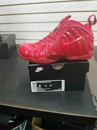 unpaired red Nike Air Foamposite Pro shoe with box