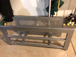 Metal media table with tempered glass shelves