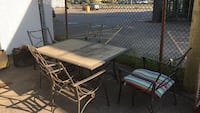 rectangular brown wooden table with four chairs patio set Montréal, H2R 1X9