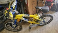 yellow and black Mongoose BMX bike