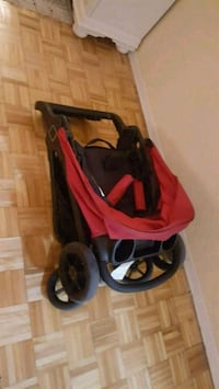 baby's red and black jogging stroller Montréal, H1M 2S3
