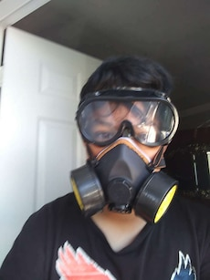 black and yellow gas mask