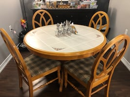 4 seater round ceramic top dining table
