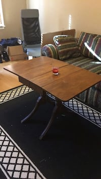 rectangular brown wooden table with chairs Arlington, 22204